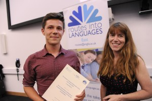 Liam Innis, receiving his award from ALL's Past President, Rachel Hawkes at the Routes into Languages Spelling Bee Final